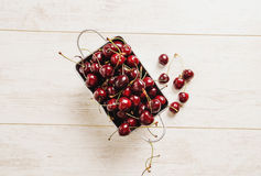 Fresh cherries in bowl on table Royalty Free Stock Image