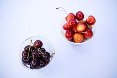 Fresh cherries in bowl on table Royalty Free Stock Images