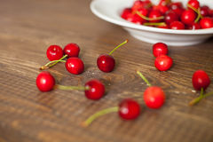 Fresh cherries  on the brown table Royalty Free Stock Photos