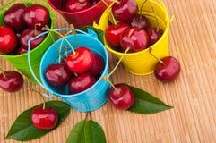 Fresh cherries in buckets Stock Photos