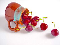 Fresh Cherries in Ceramic Cup. Fresh Cherries in  Ceramic Cup Lying on White Table Stock Image