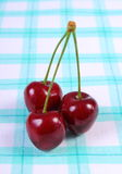 Fresh cherries on checkered tablecloth, healthy food Royalty Free Stock Images