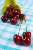 Fresh cherries on checkered tablecloth, healthy food Royalty Free Stock Photos