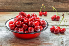 Fresh cherries. Fresh cherry on the wooden background Stock Images
