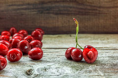 Fresh cherries. Fresh cherry on the wooden background Royalty Free Stock Images