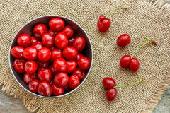 Fresh cherries. Fresh cherry on the wooden background Royalty Free Stock Photos