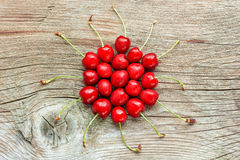 Fresh cherries. Fresh cherry on the wooden background Stock Photography