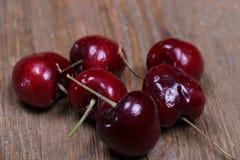 Fresh cherries on a chopping board stock photo