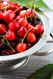 Fresh cherries in colander Royalty Free Stock Photography
