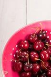 Fresh cherries in colander Royalty Free Stock Photo