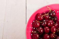 Fresh cherries in colander Stock Photos