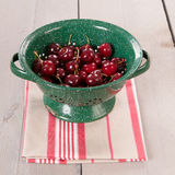 Fresh cherries in colander Stock Image