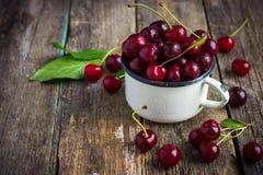 Fresh cherries in enamel mug Stock Photography