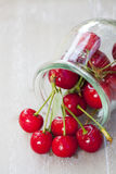 Fresh cherries in front of a preserving jar Royalty Free Stock Image