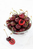 Fresh cherries in glass bowl Stock Photos