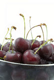 Fresh cherries in a glass bowl Royalty Free Stock Images