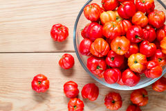 Fresh cherries in a glass bowl on wood table Royalty Free Stock Image