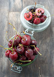 Fresh cherries in glass jar Royalty Free Stock Photography