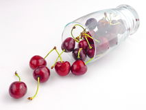 Fresh Cherries and Glass. Fresh Cherries in a Glass Lying on White Table Royalty Free Stock Photo