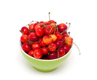 Fresh cherries in a green bowl Stock Photography