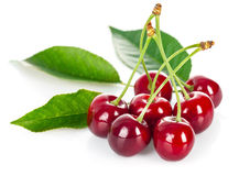 Fresh cherries with green leaves Stock Photo