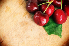 Fresh cherries with a leaf, vintage style Royalty Free Stock Image