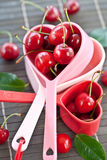 Fresh cherries in measuring cups Royalty Free Stock Image