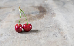 Fresh cherries on old, rustic wooden background Stock Images