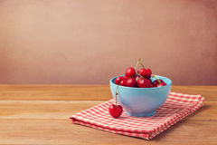 Fresh cherries over wooden background Stock Image