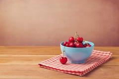 Fresh cherries over wooden background Stock Image