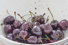Fresh Cherries in a Sieve Royalty Free Stock Image