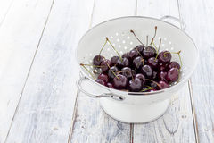 Fresh Cherries in a Sieve Stock Image