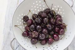 Fresh Cherries in a Sieve Royalty Free Stock Photo