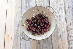 Fresh Cherries in a Sieve Royalty Free Stock Images
