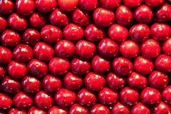 Fresh cherries are stapled in pattern Stock Image