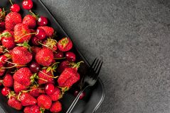 Fresh cherries and strawberries stock images