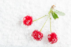 Fresh cherries in water bubbles Royalty Free Stock Photos