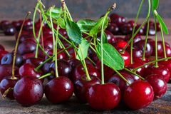 Fresh cherries with water drops on wooden table background Stock Image
