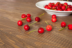 Fresh cherries in the white plate Royalty Free Stock Photography