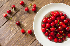 Fresh cherries in the white plate Stock Images