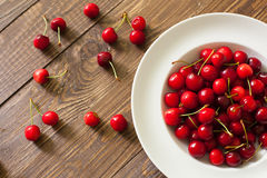 Fresh cherries in the white plate Royalty Free Stock Photo