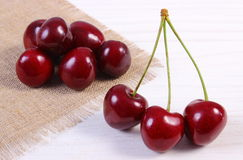 Fresh cherries on white wooden table, healthy food Stock Photo