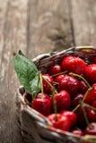 Fresh cherries in wicker basket Royalty Free Stock Photo