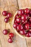 Fresh cherries on wood Stock Image