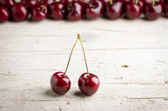 Fresh cherries. On wooden background Royalty Free Stock Photography