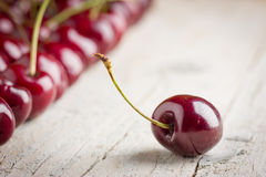 Fresh cherries. On wooden background Royalty Free Stock Photo