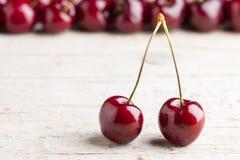 Fresh cherries on wooden background. Macro shot Stock Images