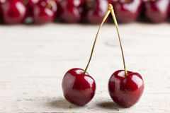 Fresh cherries on wooden background Stock Photo