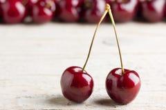 Fresh cherries on wooden background. Macro shot Stock Photo