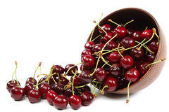 Fresh cherries in a wooden bowl on a white background. Stock Image